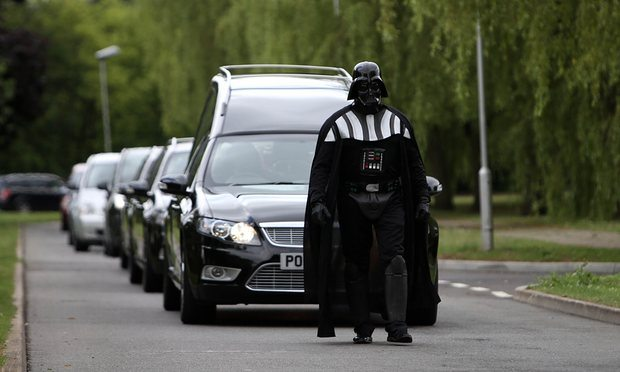 Funeral director, Brett Houghton, dressed as Darth Vader leads a cortege. Photograph: Steve Parsons/PA