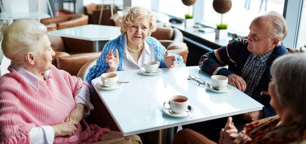 Seniors talking about death at cafe