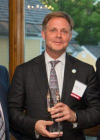 Buddy Phaneuf accepts Torch Award for Marketplace Ethics