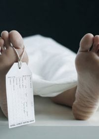 woman lying on table in morgue