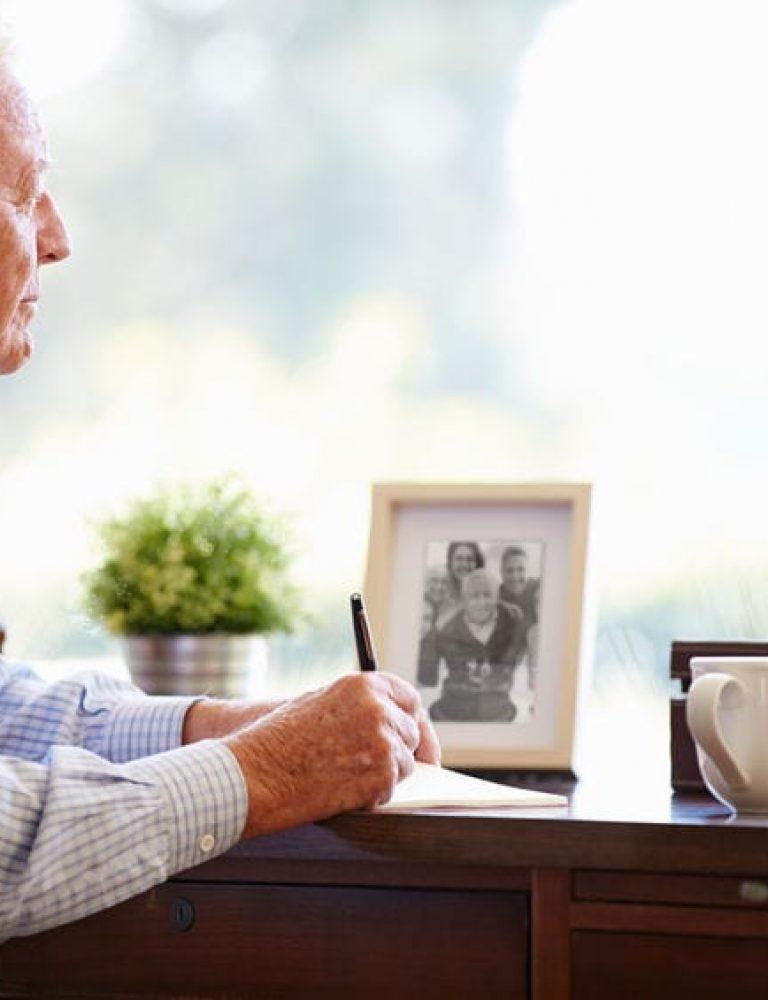 Man writing obituary