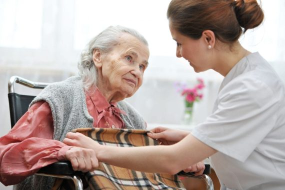 Woman in hospice with nurse