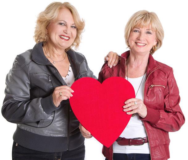 Female couple holding heart